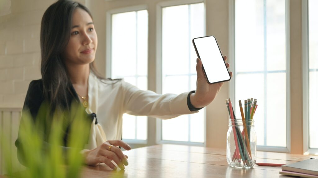 Girl holding a smartphone introducing the Corona virus health insurance package to customers.